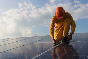 One men working at solar power station